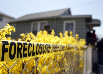 Police tape marked as a Foreclosure Free Zone is seen outside the foreclosed home of Marie Elie in Elmont, New York, April 9, 2009. REUTERS/