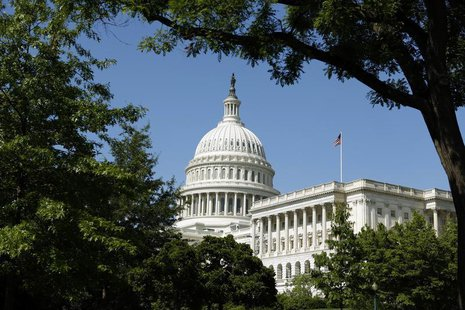 The U.S. Capitol is seen against a clear blue sky in Washington May 20, 2013. REUTERS/Kevin Lamarque