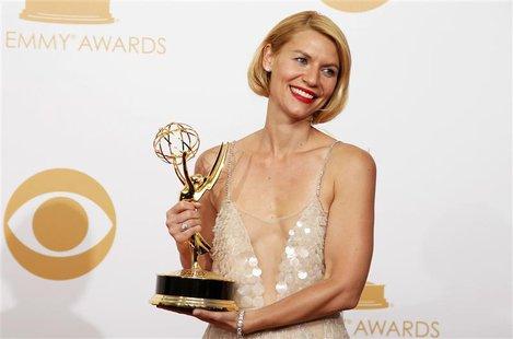 "Actress Claire Danes from Showtime's series ""Homeland"" poses backstage with her award for Outstanding Lead Actress In A Drama Series at the"