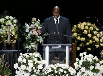 Former Lakers center Shaquille O'Neal speaks at a memorial service for the late Los Angeles Lakers owner Jerry Buss in Los Angeles, February