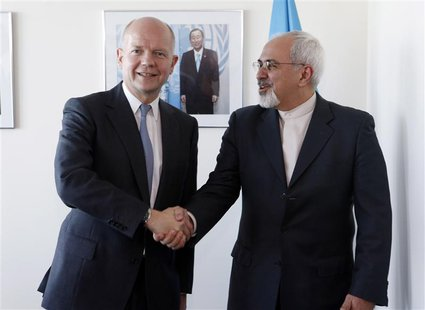 British Foreign Minister William Hague (L). shakes hands with Iran's Foreign Minister Mohammad Javad Zarif at the beginning of their bilater