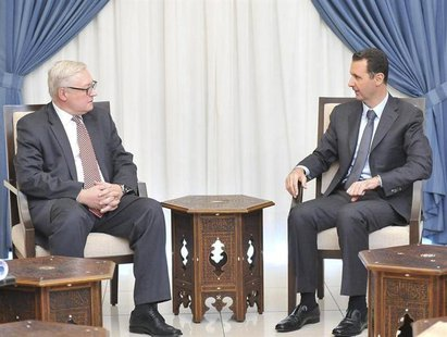 Syria's President Bashar al-Assad (R) meets Russian deputy Foreign Minister Sergei Ryabkov in Damascus, in this handout photograph distribut