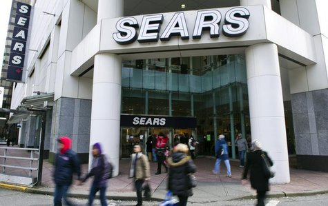People walk past the main Sears store in downtown Vancouver, British Columbia February 23, 2011. Retailer Sears Canada Inc posted a 28 perce