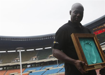 Sprinter Ben Johnson of Canada holds a cast of his footprint made after running on the track at the Seoul Olympic Stadium in Seoul September