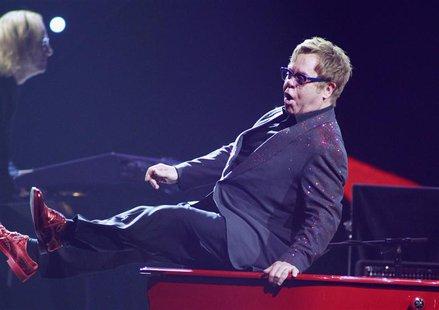 British musician Elton John performs during the iHeartRadio Music Festival at the MGM Grand Garden Arena in Las Vegas, Nevada September 20,