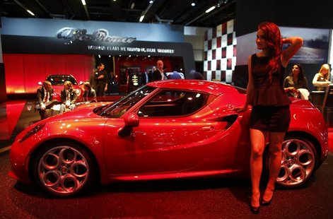 A model stands next to a Alfa Romeo 4C during a media preview day at the Frankfurt Motor Show (IAA) September 10, 2013. REUTERS/Pawel Kopczy