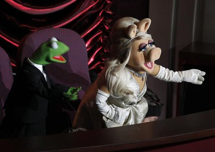Muppet characters Miss Piggy and Kermit the Frog introduce a special performance by Cirque Du Soleil at the 84th Academy Awards in Hollywood
