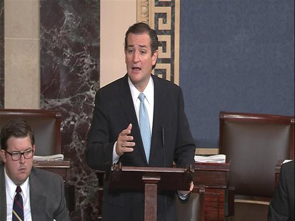 "U.S. Senator Ted Cruz (R-TX), denounces ""Obamacare"" as he speaks on the Senate floor on Capitol Hill in Washington, in this still image take"
