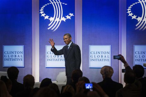 U.S. President Barack Obama waves as he departs after a discussion about healthcare at the Clinton Global Initiative (CGI) in New York Septe