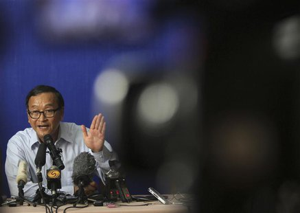 Sam Rainsy, president of the National Rescue Party, speaks during a news conference at the CNRP office in Phnom Penh September 25, 2013. REU