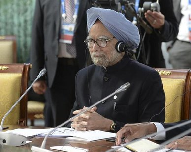 India's Prime Minister Manmohan Singh attends a BRICS leaders' meeting at the G20 Summit in Strelna near St. Petersburg, September 5, 2013.