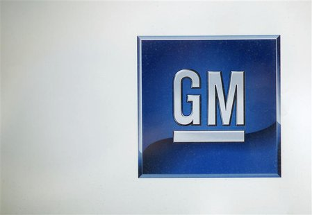 A logo at a GM dealership is seen in New York May 15, 2009. More than 100,000 jobs are at risk from the unprecedented GM and Chrysler dealer