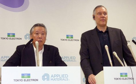 Tokyo Electron Ltd Chairman and President Tetsuro Higashi (L) and Applied Materials Inc Chief Executive Officer Gary Dickerson attend their