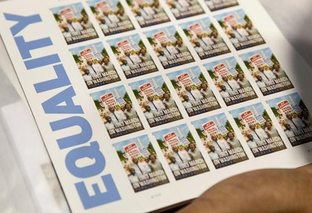 "A page of U.S. Postal Service limited-edition stamps commemorating the 1963 'March on Washington for Jobs and Freedom"" is displayed in Washi"