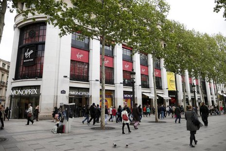 People walk near the Virgin Megastore building on the Champs Elysees in Paris May 14, 2013. REUTERS/Benoit Tessier