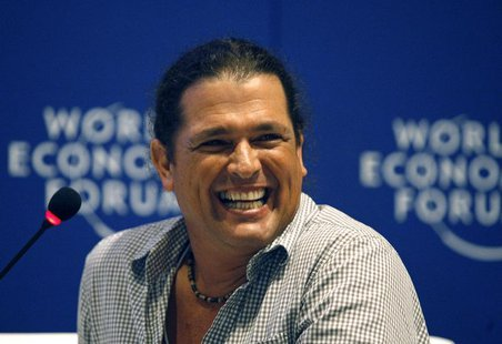 Colombian singer Carlos Vives laughs during the Music For Social Change forum at the World Economic Forum on Latin America in Cartagena Apri
