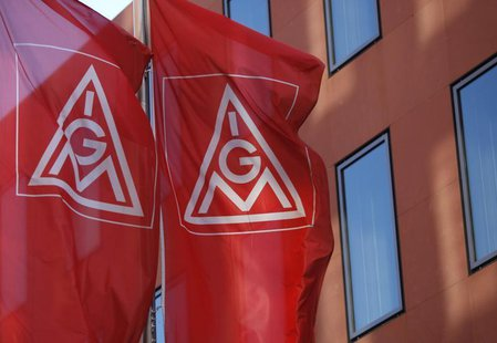 Flags of Germany's metalworkers' union IG Metall (IGM) are pictured past the IGM headquarters in Frankfurt May 3, 2012. REUTERS/Ralph Orlows