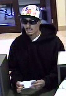 The bank robbery suspect as seen in images taken from surveillance footage.