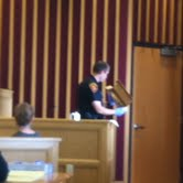 Officer Robert Erickson shows jury the knife used in the stabbing