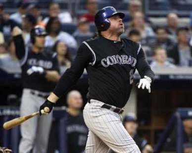 Jason Giambi while with the Colorado Rockies in 2011 action. REUTERS/Ray Stubblebine