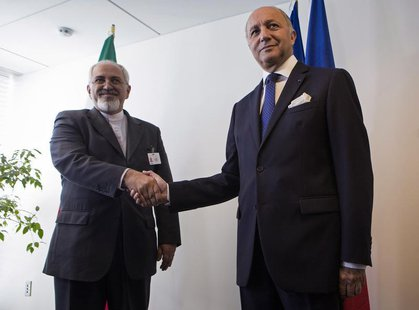 Iran's Foreign Minister Mohammad Javad Zarif (L) shakes hands with French Foreign Minister Laurent Fabius during the UN General Assembly at