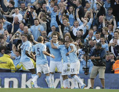 Manchester City's Sergio Aguero (16) celebrates with teamates after scoring against Manchester United during their English Premier League so