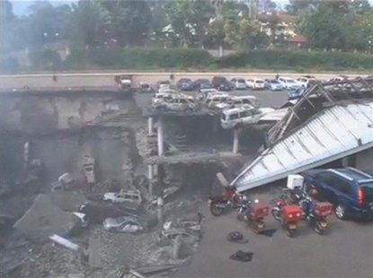 Debris and destroyed vehicles are seen at the collapsed Westgate shopping mall in Nairobi, in this still image taken from video shot Septemb