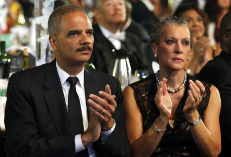 U.S. Attorney General Eric Holder and his wife Sharon Malone attend the Congressional Black Caucus Foundation Annual Phoenix Awards Dinner i