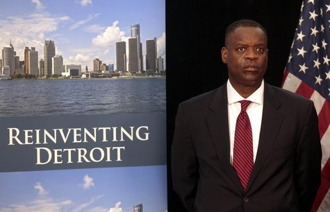 Detroit Emergency Manager Kevyn Orr waits to address the media during a news conference about filing bankruptcy for the city of Detroit in D