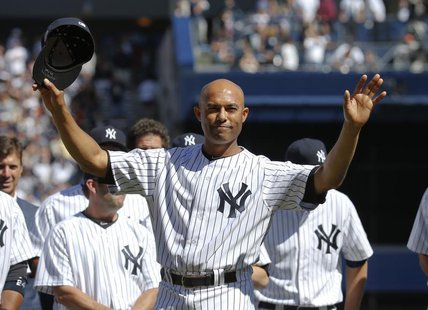 New York Yankees relief pitcher Mariano Rivera responds to the sold-out crowd during ceremonies honoring him before their MLB Interleague ba