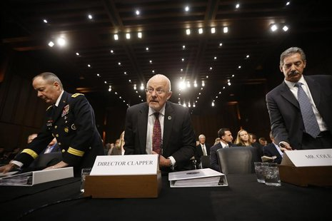 Director of National Intelligence James Clapper (C), National Security Agency Director General Keith Alexander (L) and Deputy Attorney Gener