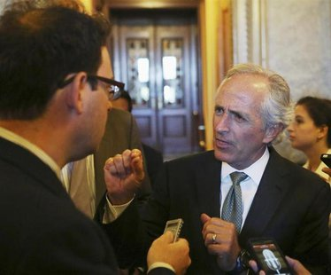 U.S. Senator Bob Corker (R-TN) (R) speaks to reporters in Washington September 24, 2013. REUTERS/Gary Cameron