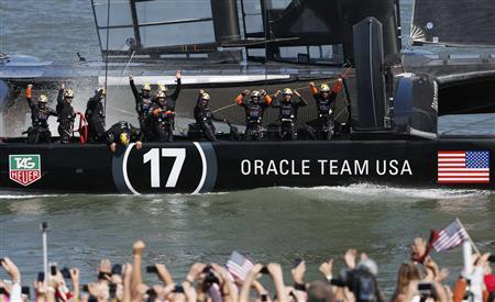 Members of the Oracle Team USA celebrate winning the overall title of the 34th America's Cup yacht sailing race over Emirates Team New Zealand in San Francisco, California September 25, 2013.  REUTERS/Stephen Lam