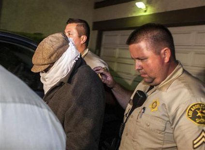 Nakoula Basseley Nakoula (L) is escorted out of his home by Los Angeles County Sheriff's officers in Cerritos, California September 15, 2012. Credit: Reuters/Bret Hartman