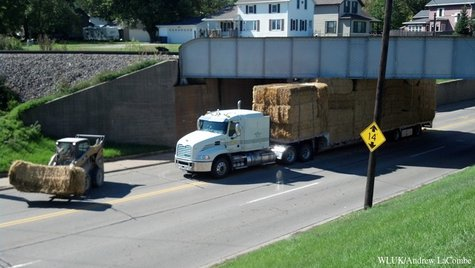 A semi truck hauling hay got stuck under a railroad overpass in De Pere on Thursday, September 26, 2013. (Photo by: FOX 11).
