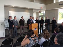 Wisconsin Attorney General J.B. Van Hollen, surrounded by local law enforcement and state legislators, speaks at King Park Pavilion as part of the statewide unveiling of a public awareness campaign against heroin.