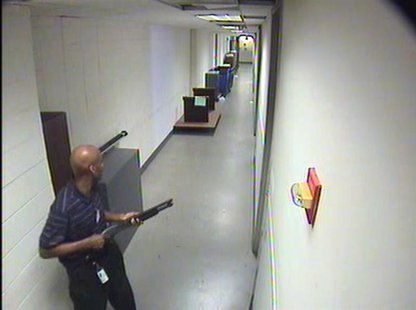 Aaron Alexis moves through the hallways of Building #197 carrying a Remington 870 shotgun in this undated handout photo released by the FBI.