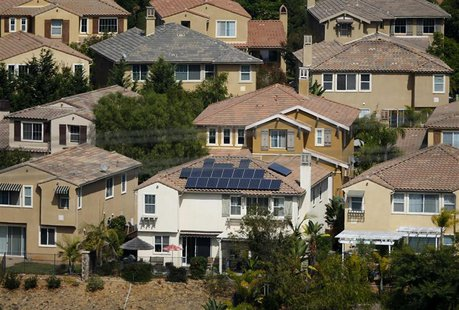A home with solar panels on its roof is shown in a residential neighborhood in San Marcos, California September 19,2013. REUTERS/Mike Blake