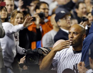 New York Yankees relief pitcher Mariano Rivera blows a kiss to the crowd as they applaud him as he leaves the game with the Tampa Bay Rays i
