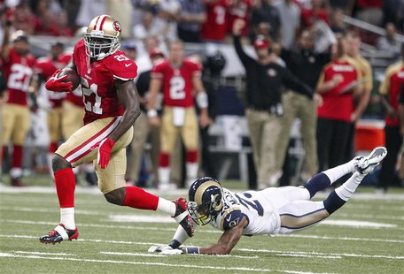San Francisco 49ers running back Frank Gore (L) gets past St. Louis Rams free safety Rodney McLeod to run in a touchdown during the first ha