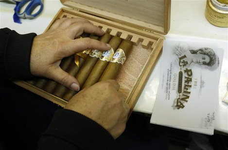 Niurka Perez packs a box of cigars at the El Titan de Bronze cigar factory and store in the Little Havana neighborhood of Miami, Florida Sep