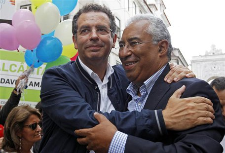 Portuguese Socialist Party general secretary and main opposition leader Antonio Jose Seguro (L) embraces Lisbon mayoral candidate Antonio Co