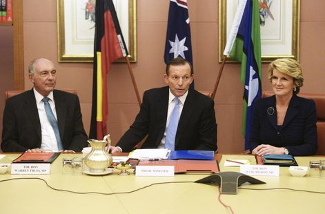 Australia's new conservative Prime Minister Tony Abbott (C) sits between his Foreign Minister Julie Bishop (R) and deputy Prime Minister, Wa