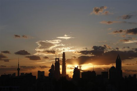 The sunrise rises over the skyline of Lujiazui financial district of Pudong in Shanghai September 27, 2013. REUTERS/Aly Song