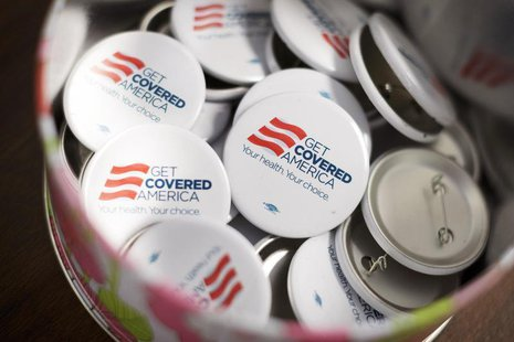 Get Covered America buttons are seen during a training session in Chicago, Illinois September 7, 2013 before volunteers canvas a Chicago nei