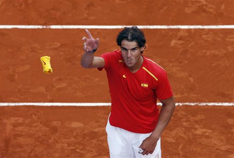 Spain's Rafael Nadal throws his wristband to the public after winning against Ukraine at the end of their Davis Cup World Group playoff tenn