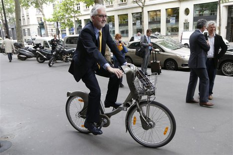 British Cycling President Brian Cookson rides a Velib self-service public bicycle during a photo session after a news conference in Paris Ju