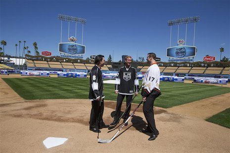 Los Angeles Kings' Drew Doughty (L-R), Jeff Carter, and Anaheim Ducks Dustin Penner chat after a news conference at Dodgers Stadium in Los A