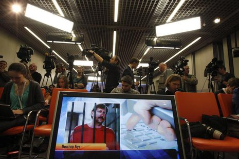 Journalists attend a news conference of Russian arms dealer Viktor Bout, his wife Alla and lawyer Albert Dayan via a video link from the U.S