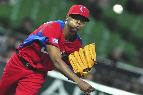 Cuba's Raciel Iglesias pitches a ball during the last preparation game for the World Baseball Classic (WBC) in Fukuoka in this March 1, 2013